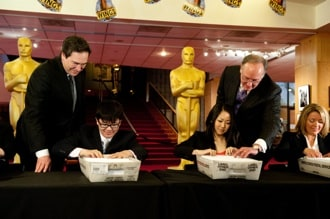 Rick Rosas and Brad Oltmanns supervise Oscar ballot mailing