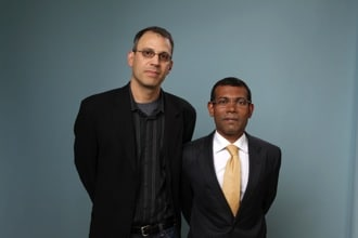 (Photo of Jon Shenk, left, and Mohamed Nasheed by Matt Carr/Getty Images)
