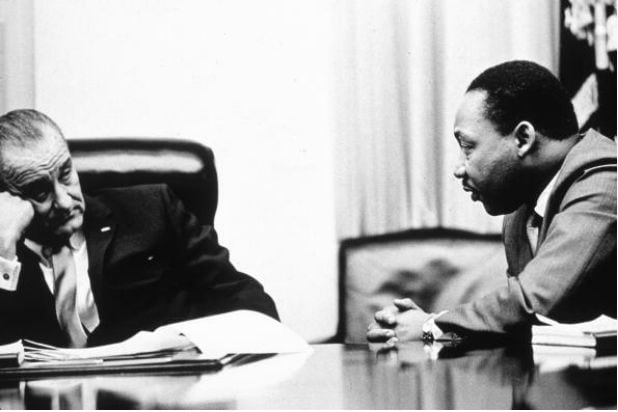 Former president Lyndon B. Johnson and Dr. Martin Luther King Jr.