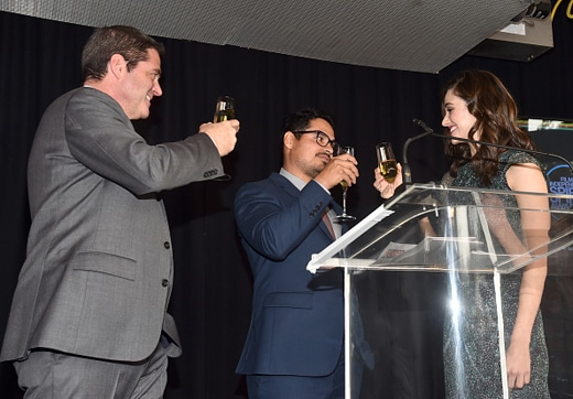 WEST HOLLYWOOD, CA - JANUARY 10: (L-R) President of Film Independent Josh Welsh, Co-hosts Michael Pena and Emmy Rossum speak onstage during the 2015 Film Independent Filmmaker Grant and Spirit Awards nominee brunch at BOA Steakhouse on January 10, 2015 in West Hollywood, California. (Photo by Alberto E. Rodriguez/WireImage)