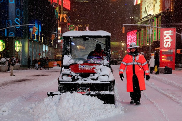 NEW YORK, NY - JANUARY 26: A plow is driven through Times Square on January 26, 2015 in New York City. New York, and much of the Northeast, is bracing for a major winter storm which is expected to bring blizzard conditions and 10 to 30 inches of snow to the area. (Photo by Alex Trautwig/Getty Images)