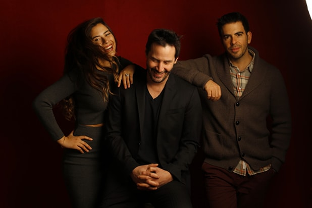 """Knock Knock"" stars Lorenza Izzo and Keanu Reeves with director Eli Roth (l-r), photographed by Patrick Fraser at TheWrap's Kia photobooth during the 2015 Sundance Film Festival in Park City, Utah on Jan. 23, 2015."