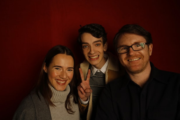 """Slow West"" stars Caren Pistorious and Kodi Smit-McPhee with director John MacLean, photographed by Patrick Fraser at TheWrap's Kia photobooth during the 2015 Sundance Film Festival in Park City, Utah on Jan. 23, 2015."
