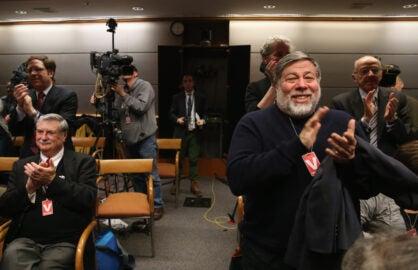Apple Co-Founder Steve Wozniak (R) applauds FCC vote (Mark Wilson/Getty Images)