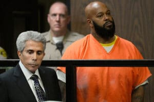 COMPTON, CA - FEBRUARY 03: Marian 'Suge' Kinght (R) and his Lawyer David E Kenner (L) appear at his arraignmet at Compton Courthouse on February 3, 2015 in Compton, California. Knight is charged with murder and attempted murder after a hit-and-run incident following an argument in a parking lot on January 29. (Photo by Paul Buck - Pool/Getty Images)