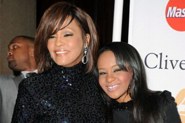 Singer Whitney Houston (L) and Bobbi Kristina Brown arrives at the 2011 Pre-GRAMMY Gala and Salute To Industry Icons Honoring David Geffen at Beverly Hilton on February 12, 2011 in Beverly Hills, California. (Photo by Jason Merritt/Getty Images)