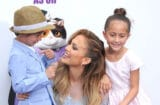 WESTWOOD, CA - MARCH 22: Recording Artist/actress Jennifer Lopez (C) and son Maximilian David Muniz (L) and daughter Emme Maribel Muniz (R) arrive at Twentieth Century Fox And Dreamworks Animation's 'Home' Premiere at Regency Village Theatre on March 22, 2015 in Westwood, California. (Photo by Barry King/Getty Images)