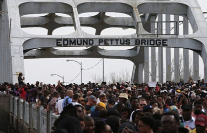 MARCH 08: Thousands of people walk across the Edmund Pettus Bridge during the 50th anniversary commemoration of the Selma to Montgomery civil rights march on March 8, 2015 in Selma, Alabama. Tens of thousands of people gathered in Selma to commemorate the 50th anniversary of the famed civil rights march from Selma to Montgomery that resulted in a violent confrontation with Selma police and State Troopers on the Edmund Pettus Bridge on March 7, 1965. (Photo by Justin Sullivan/Getty Images)