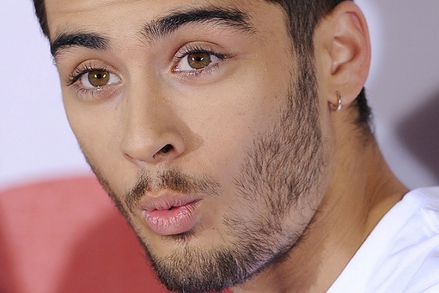 LONDON, UNITED KINGDOM - AUGUST 19: Zayn Malik of One Direction attends a photocall to launch their new film 'One Direction: This Is Us 3D' on August 19, 2013 in London, England. (Photo by Stuart C. Wilson/Getty Images)