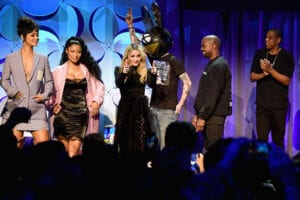 NEW YORK, NY - MARCH 30: (L-R) Rihanna, Nicki Minaj, Madonna, Deadmau5, Kanye West, JAY Z, and J. Cole onstage at the Tidal launch event #TIDALforALL at Skylight at Moynihan Station on March 30, 2015 in New York City. (Photo by Jamie McCarthy/Getty Images for Roc Nation)