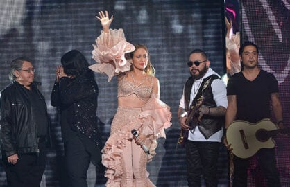 MIAMI, FL - APRIL 30: Jennifer Lopez and Los Dinos onstage after performing musical tribute to Selena at the 2015 Billboard Latin Music Awards presented bu State Farm on Telemundo at Bank United Center on April 30, 2015 in Miami, Florida. (Photo by Rodrigo Varela/Getty Images)
