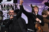 aption:CLEVELAND, OH - APRIL 18: Sir Paul McCartney (L) and inductee Ringo Starr perform onstage during the 30th Annual Rock And Roll Hall Of Fame Induction Ceremony at Public Hall on April 18, 2015 in Cleveland, Ohio. (Photo by Mike Coppola/Getty Images)