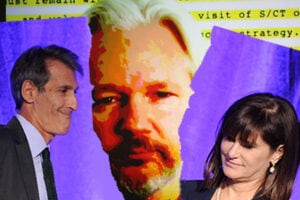 Sony Pictures Entertainment CEO Michael Lyntonwith former SPE President Amy Pascal; WikiLeaks founder Julian Assange (Kevin Winter/Hannah Peters/Getty Images)