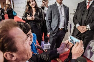 NEW YORK, NY - APRIL 22: (EDITORS NOTE: This image was processed using digital filters) Arnold Schwarzenegger takes a selfie with kids at the premiere of 'Maggie' during the 2015 Tribeca Film Festival at BMCC Tribeca PAC on April 22, 2015 in New York City. (Photo by Grant Lamos IV/Getty Images for the 2015 Tribeca Film Festival)