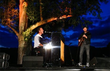 Chris Martin and Jonny Buckland surprised guests at the Communities in Schools Los Angeles Benefit, the country's leading dropout prevention organization. (Getty Images)