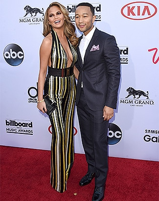 LAS VEGAS, NV - MAY 17: Host Chrissy Teigen (L) and musician John Legend attend the 2015 Billboard Music Awards at MGM Grand Garden Arena on May 17, 2015 in Las Vegas, Nevada. (Photo by Jason Merritt/Getty Images)