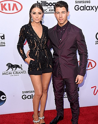 LAS VEGAS, NV - MAY 17: Singer Nick Jonas (R) and model Olivia Culpo attend the 2015 Billboard Music Awards at MGM Grand Garden Arena on May 17, 2015 in Las Vegas, Nevada. (Photo by Jason Merritt/Getty Images)