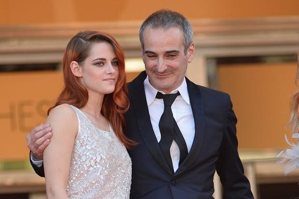 Kristen Stewart and director Olivier Assayas (Michael Buckner/Getty Images)