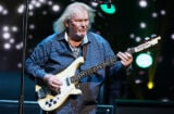Caption:NEW YORK, NY - JULY 09: Chris Squire of the British band Yes performs at Radio City Music Hall on July 9, 2014 in New York City. (Photo by Dave Kotinsky/Getty Images)