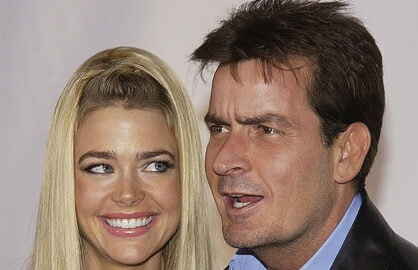 BEVERLY HILLS, CA - SEPTEMBER 9: Actor Charlie Sheen and wife, actress Denise Richards attend the inaugural 'Rodeo Drive Walk of Style' event honoring designer Giorgio Armani on September 9, 2003 in Beverly Hills, California. (Photo by Vince Bucci/Getty Images)