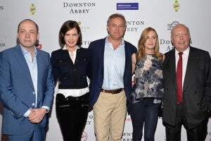 BEVERLY HILLS, CA - JUNE 06: (L-R) Producer Gareth Neame, actors Elizabeth McGovern, Hugh Bonneville and Laura Carmichael and writer Julian Fellowes arrive at the Afternoon With 'Downton Abbey' Talent Panel at the Writers Guild Theater on June 6, 2015 in Beverly Hills, California. (Photo by Amanda Edwards/WireImage)