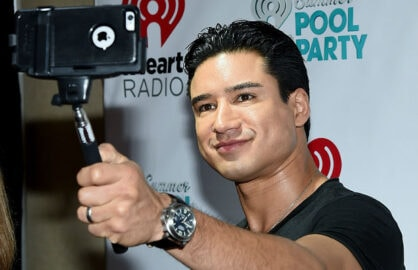 Mario Lopez uses a selfie stick at the iHeartRadio Summer Pool Party