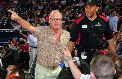 ATLANTA, GA - JUNE 5: Actor and noted Pittsburgh Pirates fan Michael Keaton playfully points to the scoreboard to a fan of the Atlanta Braves during the Pirates game against the Braves at Turner Field on June 5, 2015 in Atlanta, Georgia. (Photo by Scott Cunningham/Getty Images)