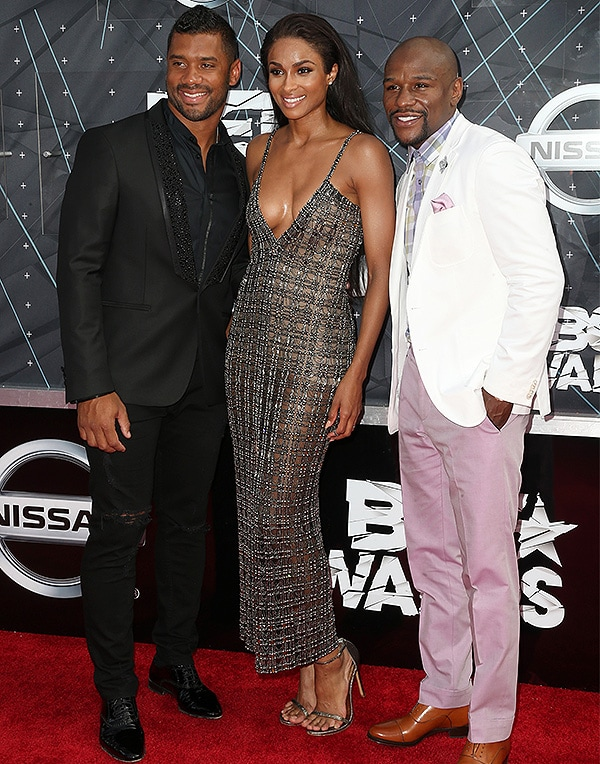 LOS ANGELES, CA - JUNE 28: (L-R) Professional football player Russell Wilson, recording artist Ciara and professional boxer Floyd Mayweather Jr. attend the 2015 BET Awards at the Microsoft Theater on June 28, 2015 in Los Angeles, California. (Photo by Frederick M. Brown/Getty Images for BET)