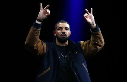 Drake appears on stage to introduce the Apple Music streaming service