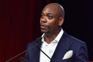 WATER MILL, NY - JULY 18: Dave Chappelle speaks on stage as RUSH Philanthropic Arts Foundation Celebrates 20th Anniversary at Art For Life sponsored by Bombay Sapphire Gin at Fairview Farms on July 18, 2015 in Water Mill, New York. (Photo by Eugene Gologursky/Getty Images for Bombay Sapphire Gin)