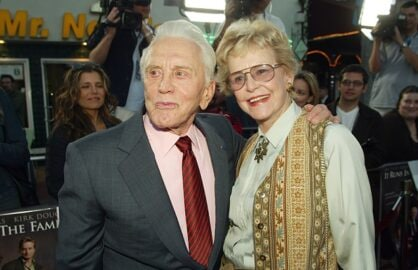 "LOS ANGELES - APRIL 7: Actor Kirk Douglas (L) poses with actress and ex-wife Diana Douglas at the premiere of ""It Runs In The Family"" at the Bruin Theater on April 7, 2003 in Los Angeles, California. (Photo by Kevin Winter/Getty Images)"