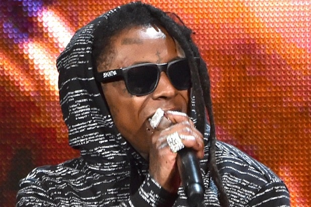 LOS ANGELES, CA - NOVEMBER 23: Recording artist Lil Wayne performs onstage at the 2014 American Music Awards at Nokia Theatre L.A. Live on November 23, 2014 in Los Angeles, California. (Photo by Kevin Winter/Getty Images)