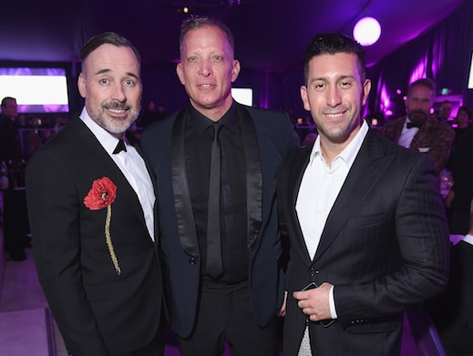 Cooley (center) with Elton John Aids Foundation Chair David Furnish (left) at Sir Elton's annual Oscar night in West Hollywood. (Dimitrios Kambouris/Getty Images  for EJAF)