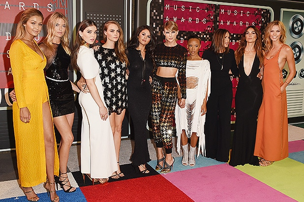LOS ANGELES, CA - AUGUST 30: (L-R) Models Gigi Hadid, Martha Hunt, actress Hailee Steinfeld, model Cara Delevingne, actress Selena Gomez, musician Taylor Swift, model Serayah, actress Mariska Hargitay, models Lily Aldridge and Karlie Kloss attend the 2015 MTV Video Music Awards at Microsoft Theater on August 30, 2015 in Los Angeles, California. (Photo by Jason Merritt/Getty Images)