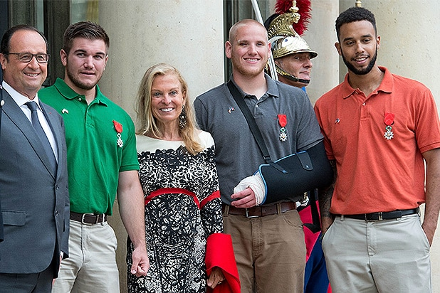 PARIS, FRANCE - AUGUST 24: French President, Francois Hollande (L) receives US-France Ambassador, Jane Hartley (C) and honorees at Elysee Palace on August 24, 2015 in Paris, France. Spencer Stone (2R), Anthony Sadler (R) and Alek Skarlatos (2L) are being awarded the Legion d'Honneur after overpowering the gunman, 25-year-old Moroccan, Ayoub El-Khazzani, on board a high-speed train after he opened fire on a Thalys train travelling from Amsterdam to Paris. El-Khazzani, who had a Kalashnikov, an automatic pistol and a box cutter, was arrested when the train stopped at the French town of Arras. (Photo by Aurelien Meunier/Getty Images)