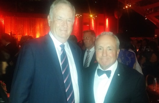 The team was organic to HBO's tent, not a camera fault. These two make an odd couple, but good conversation: Bill O'Reilly and Lorne Michaels. (Mikey Glazer)