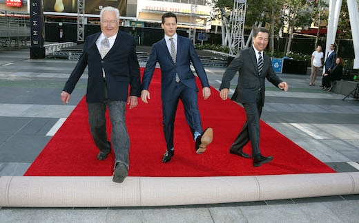 LOS ANGELES, CA - SEPTEMBER 16: (L-R) Executive producer Don Mischer, host Andy Samberg, and Television Academy Chairman/CEO Bruce Rosenblum attend the 67th Annual Primetime Emmy Awards Press Preview Day Red Carpet Rollout & Governors Ball Reveal at the Microsoft Theater on September 16, 2015 in Los Angeles, California. (Photo by Frederick M. Brown/Getty Images)