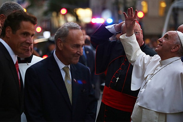 NEW YORK, NY - SEPTEMBER 24: Pope Francis acknowledges well-wishers outside St. Patrick's Cathedral as New York Gov. Andrew Cuomo (L) and U.S. Sen. Chuck Schumer (D-NY) watch on September 24, 2015. The pope is on a six-day visit to the U.S., with stops in Washington, New York City and Philadelphia. (Photo by Damon Winter-Pool/Getty Images)