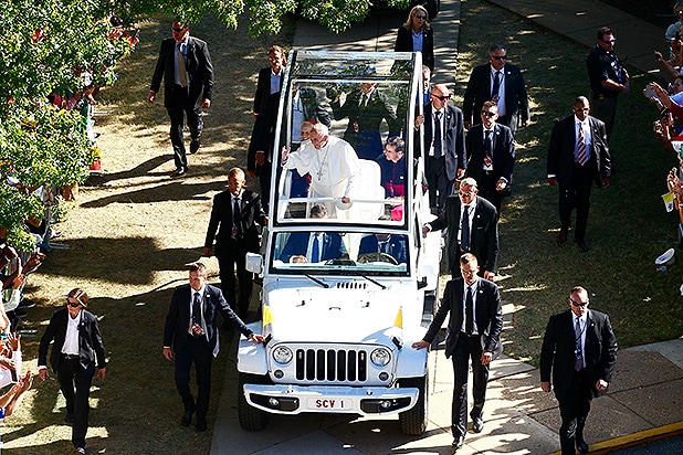 WASHINGTON D.C, UNITED STATES - SEPTEMBER 23: Pope Francis rides through his specially-made Jeep Popemobile during a parade in Washington D.C, United States on September 23, 2015. (Getty Images)