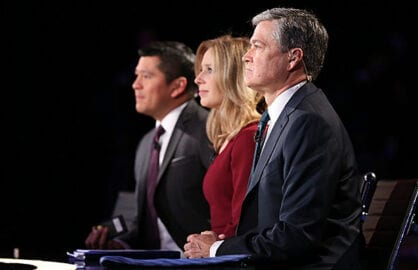 CNBC moderators Carl Quintanilla, Becky Quick and John Harwood