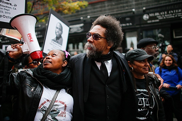 NEW YORK, NY - OCTOBER 24: Cornel West (C) Meko Williams, mother of LaReko Williams (L) and Dionne Smith Downs (R) attend a march to denounce police brutality in Washington Square Park October 24, 2015 in New York City. The rally is part of a three-day demonstration against officer-involved abuse and killing. (Photo by Kena Betancur/Getty Images)