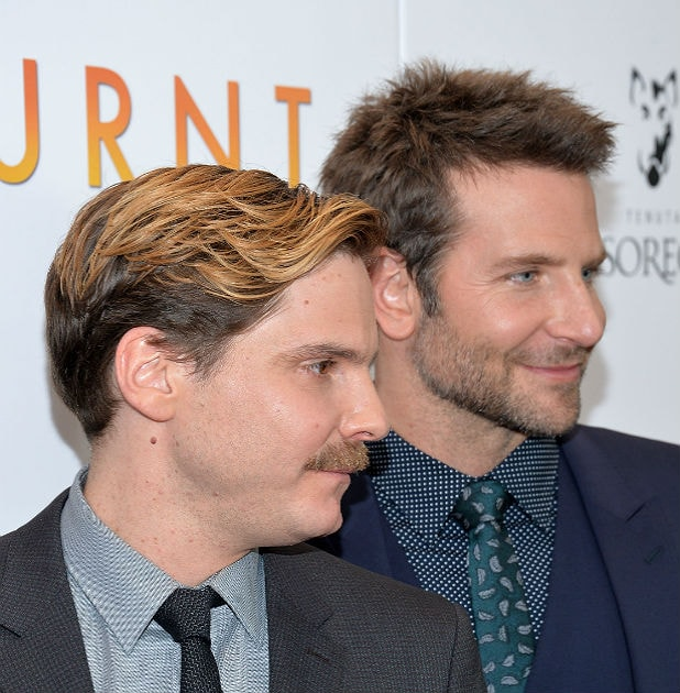 Daniel Bruhl and Bradley Cooper/Getty Images