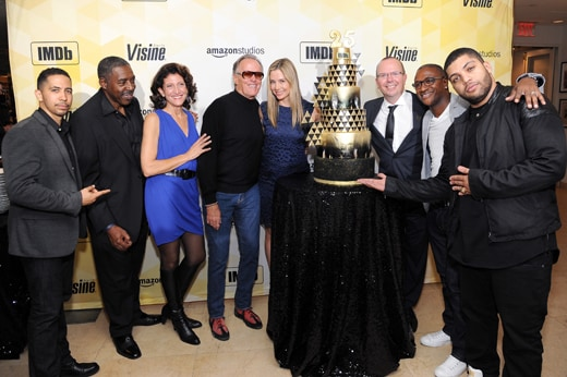 WEST HOLLYWOOD, CA - OCTOBER 15: (L-R) Actor Neil Brown Jr., actor Ernie Hudson, actress Amy Aquino, actor Peter Fonda, actress Mira Sorvino, IMDb founder and CEO Col Needham, comedian Tommy Davidson and actor O'Shea Jackson Jr. pose with a birthday cake during IMDb's 25th Anniversary Party co-hosted by Amazon Studios presented by VISINE at Sunset Tower Hotel on October 15, 2015 in West Hollywood, California. (Photo by Angela Weiss/Getty Images for IMDb)