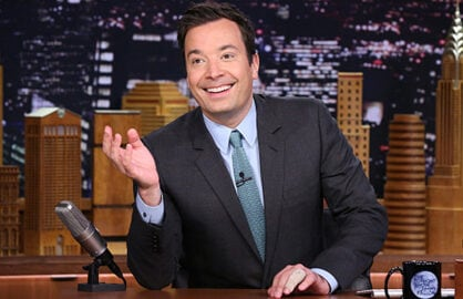 THE TONIGHT SHOW STARRING JIMMY FALLON -- Episode 0350 -- Pictured: Host Jimmy Fallon arrives at his desk on October 14, 2015 -- (Photo by: Douglas Gorenstein/NBC/NBCU Photo Bank via Getty Images)