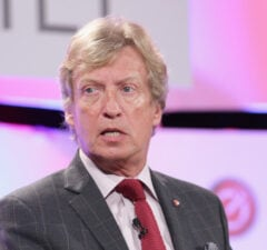 """BEVERLY HILLS, CA - OCTOBER 06: Nigel Lythgoe, Executive Producer """"American Idol"""" speaks onstage during TheWrap's 6th Annual TheGrill at Montage Beverly Hills on October 6, 2015 in Beverly Hills, California. (Photo by Alison Buck/Getty Images for TheWrap)"""