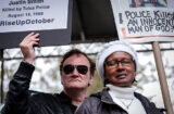NEW YORK, NY - OCTOBER 24: Director Quentin Tarantino holds a banner as attends a rally to denounce police brutality in Washington Square Park October 24, 2015 in New York City. The rally is part of a three-day demonstration against officer-involved abuse and killing. (Photo by Kena Betancur/Getty Images)