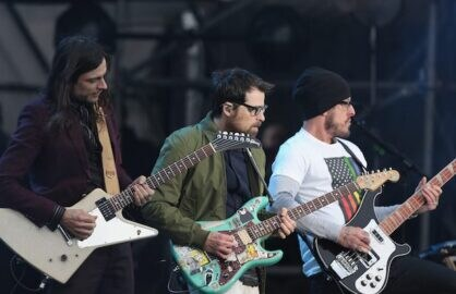 INDIANAPOLIS, IN - APRIL 03:  Brian Bell (L), Rivers Cuomo and Scott Shriner of Weezer performs onstage during the AT&T Block Party at the NCAA March Madness Music Festival Ð Day 1 at White River State Park.  (Photo by Tasos Katopodis/Getty Images for Turner)