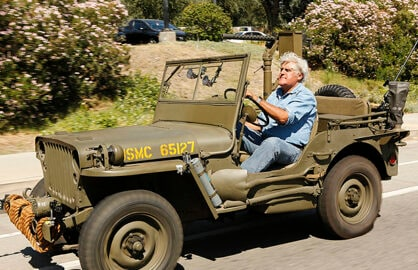 """JAY LENO'S GARAGE -- Pictured: Jay Leno. """"Jay Leno's Garage"""" premieres Wednesday, October 7 on CNBC. -- (Photo by: Vivian Zink/NBC)"""
