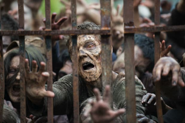 "Zombies struggle behind a gate in AMC's ""The Walking Dead"""