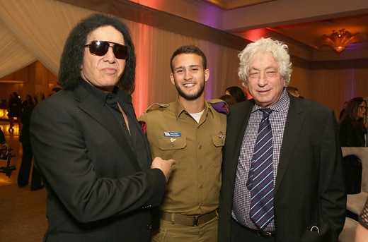 BEVERLY HILLS, CA - NOVEMBER 05: (L-R) Musician Gene Simmons, IDF soldier and producer Avi Lerner attend Friends Of The Israel Defense Forces Western Region Gala at The Beverly Hilton Hotel on November 5, 2015 in Beverly Hills, California. (Photo by Tiffany Rose/WireImage)